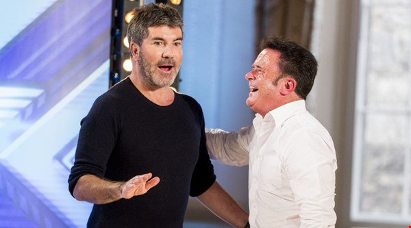 Simon Cowell comes face-to-face with his doppelganger and a former contestant reappears on tonight's X Factor