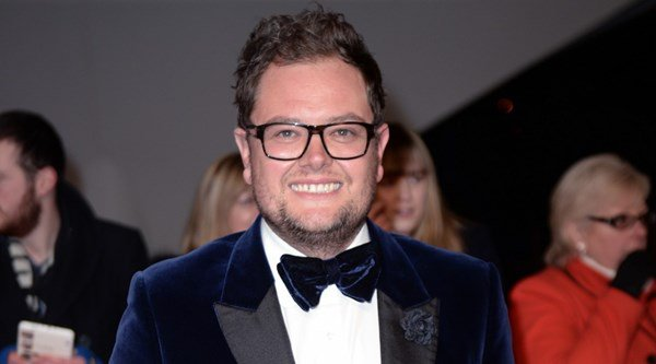 Alan Carr's set to marry his boyfriend and wants Adele to sing at the do