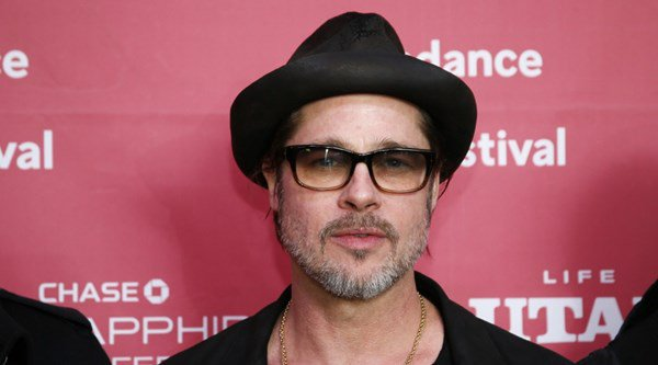 Brad Pitt to miss movie premiere to focus on 'family situation'