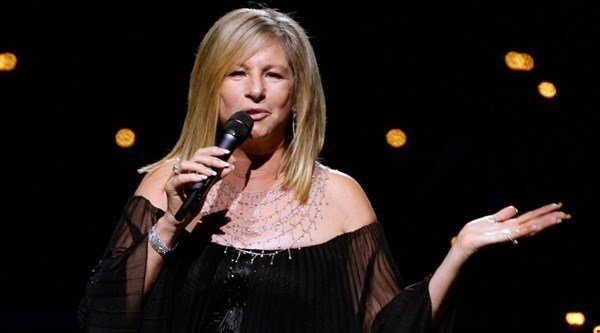 Which two acts are likely to knock Barbra Streisand off the top of the album chart this week?