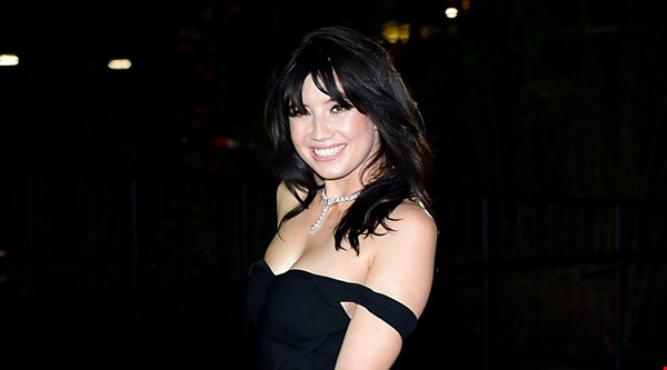 Daisy Lowe takes a break from Strictly Come Dancing training to show off her figure at GQ Men of the Year Awards