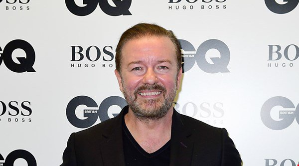 Ricky Gervais ribs partner Jane as he receives GQ genius award
