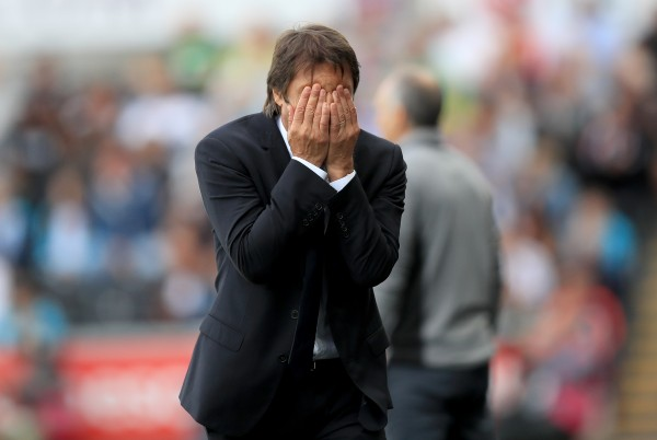 Antonio Conte with hands on face