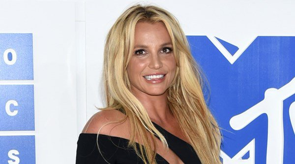 Check out Britney Spears in a 'dog pile' with her dancers