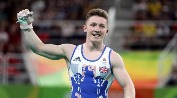 British Rio medallist Nile Wilson does daredevil gymnastics off the side of a bus