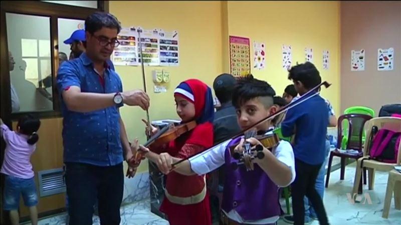 Iraqi Kids Find Refuge in Music