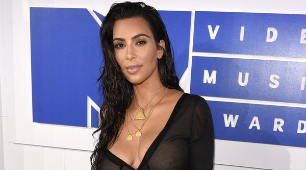 Kim Kardashian goes without make-up at Paris Fashion Week
