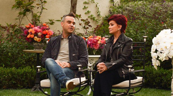 Robbie Williams does a spot of gardening on The X Factor