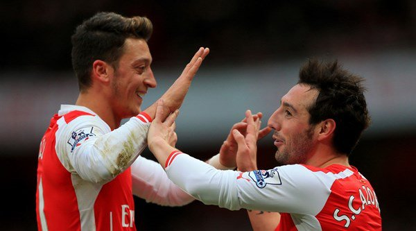 Watch as Santi Cazorla and Mesut Ozil swap match day for the microphone
