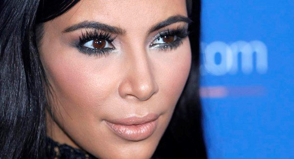 Kim Kardashian held up at gunpoint by fake police officers in Paris hotel room