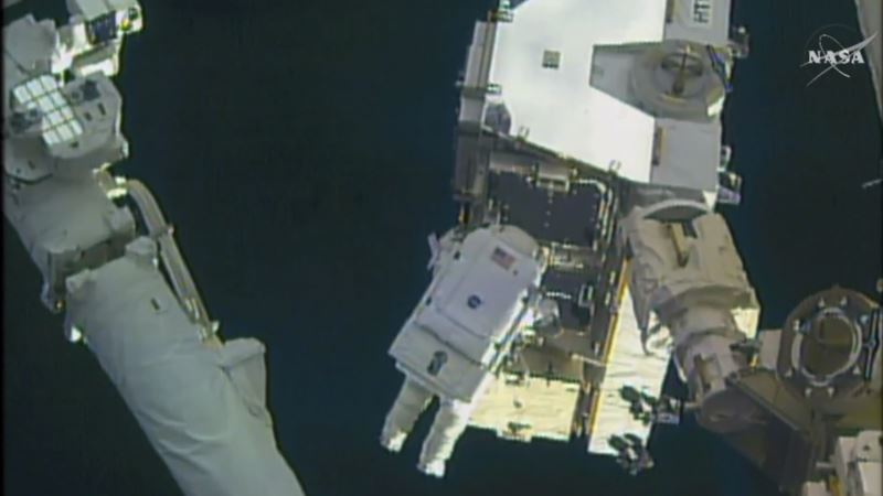 Spacewalking Astronauts Tackle Battery Work Outside Station