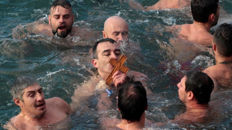 Swimmers, Singers and Sled Speedsters Mark Epiphany Feast Day