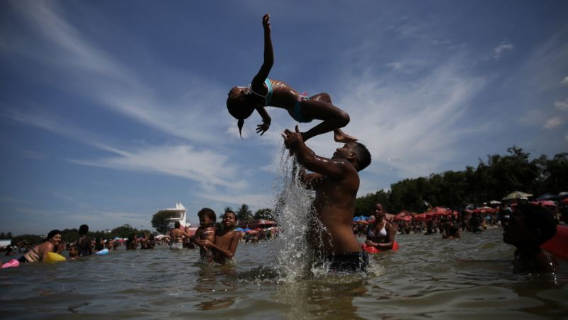 Blue-collar Bathers Revel at Alternative to Rio Beach Scene