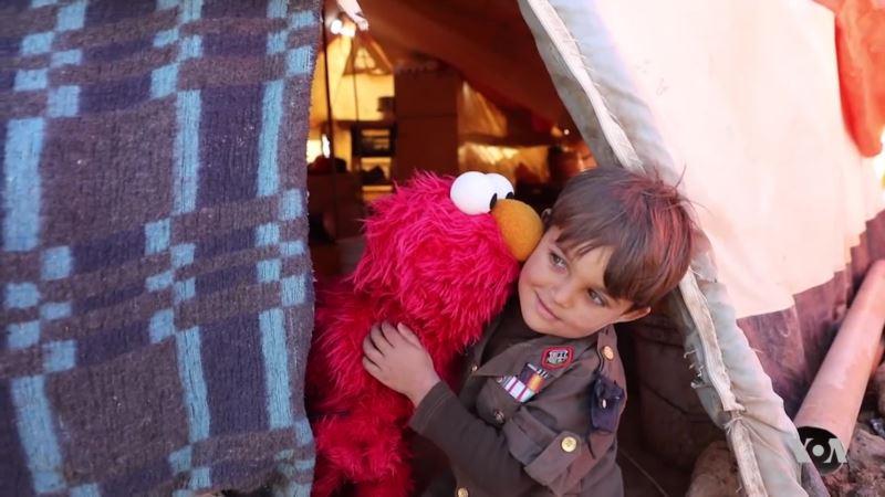 Elmo and Friends Lead Education Effort for Refugee Children