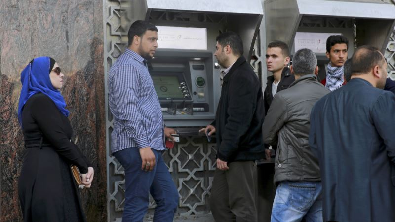Palestinian Government Slashes Salaries for Gaza Employees