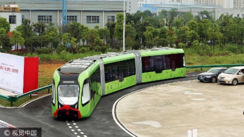 Driverless Bus-train Hybrid Runs on Virtual Painted Tracks