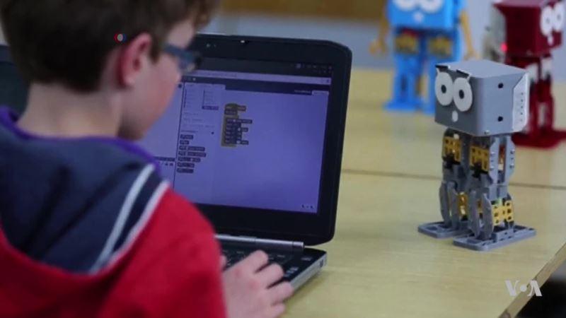 Children Learn to Program Toy Robots