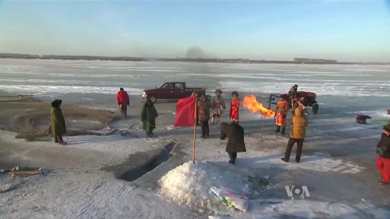 Annual Winter Fishing Festival Under a Frozen Lake in China