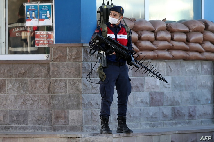 A Turkish soldier patrols next to the entrance of the Sincan Penal Institution at the 4th Heavy Penal Court near Ankara, on…