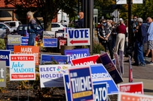 FILE - Voters wait in line to cast their ballots on the second day of early voting in in Noblesville, Indiana, Oct. 7, 2020.