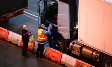 Stranded in England, Truckers Spend Christmas in Their Cabs
