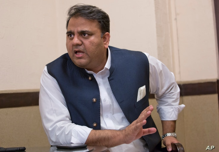 In this Sept. 25, 2018 photo, Pakistani Information Minister Fawad Chaudhry speaks to The Associated Press, in Islamabad.