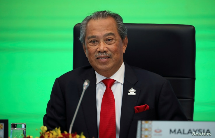 FILE - Malaysia?s Prime Minister Muhyiddin Yassin speaks during opening remarks for virtual APEC Economic Leaders Meeting 2020, in Kuala Lumpur, Malaysia, Nov. 20, 2020.