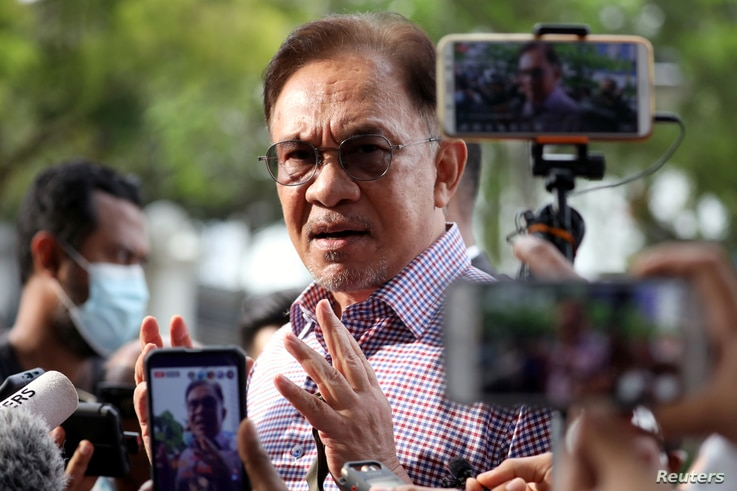 FILE - Malaysia opposition leader Anwar Ibrahim speaks to media members.