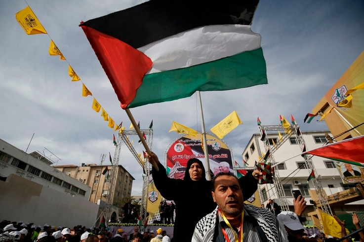 Supporters of the Palestinian Fatah movement take part in a rally marking the 55th foundation anniversary of the political…
