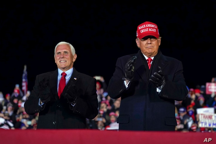 President Donald Trump arrives for a campaign rally at Gerald R. Ford International Airport, Monday, Nov. 2, 2020, in Grand…