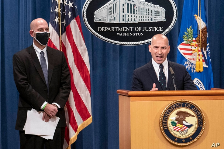 Steven D'Antuono, head of the Federal Bureau of Investigation Washington field office, left, listens as acting U.S…