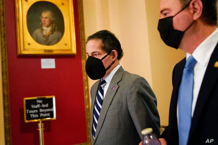 Rep. Jamie Raskin, D-Md., left, walks with Rep. Adam Schiff, D-Calif., on Capitol Hill in Washington, Wednesday, Jan. 13, 2021…
