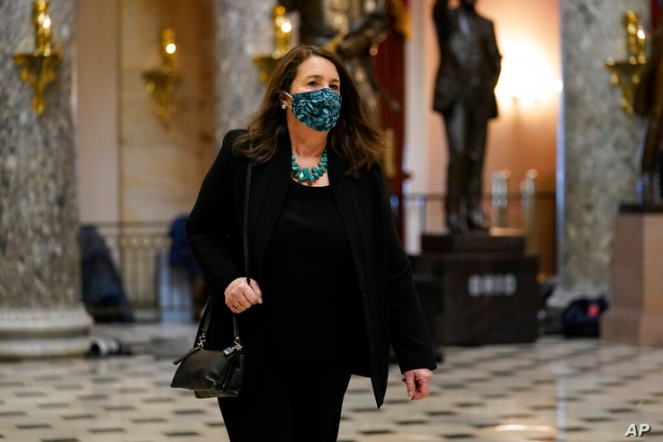 Rep. Diana DeGette, D-Colo., walks on Capitol Hill in Washington, Wednesday, Jan. 13, 2021. (AP Photo/Susan Walsh)