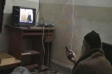 FILE - This undated image from video, seized from the walled compound of al-Qaida leader Osama bin Laden in Abbottabad, Pakistan, and released by the U.S. Department of Defense, May 7, 2011, shows a man, identified as Osama bin Laden, watching then-p