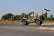 A U.S. military vehicle, part of a convoy, arrives near Dahuk, Iraqi, Monday, Oct. 21, 2019. Defense Secretary Mark Esper said…