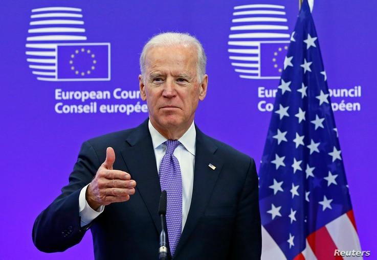 FILE - Then-U.S. Vice President Joe Biden speaks ahead of a meeting at European Council headquarters in Brussels, Belgium, Feb. 6, 2015.
